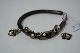 A striking Italian vintage necklet, 1970's, of scaled design, enclosed by a scrolling metal mount