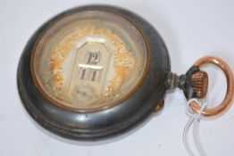 A late 19th century Systeme Brevete gun-metal mounted digital display pocket watch, probably
