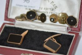 A pair of gentleman's 14ct gold and black onyx cufflinks, each rectangular plaque within a gold