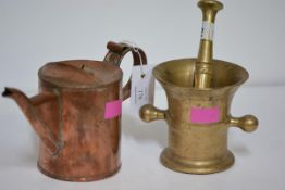 A bronze twin-handled mortar and pestle, the mortar with incised bands and of waisted shape,