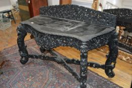An Anglo-Indian carved hardwood side table, the serpentine top with bird and foliate-carved