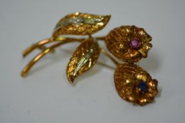 A vintage Italian 18ct gold floriform brooch, set with a round cut sapphire, ruby and with four