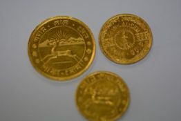 "Three Indian gold coins, 1 Tola and two 1/2 Tolas (3), each stamped ""Pure Gold Fine 9950"". Total"