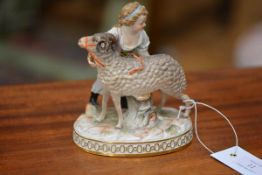 A Meissen porcelain group, of a young girl with a ram, on an oval base moulded with foliage, (