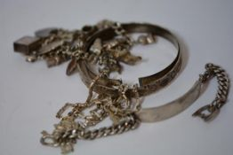 A group of vintage silver jewellery comprising: a charm bracelet with various charms including ten