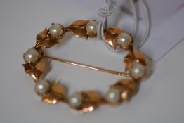 A yellow metal and cultured pearl brooch, of oval leaf form, set with uniform cultured pearls,