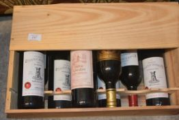 A mixed case of nine assorted bottles including Chateau Tour St. Bonnet 1997 and Chateau Cauzin