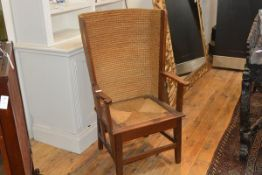 An early 20th century oak-framed Orkney chair, of characteristic form with wing back, outscrolled