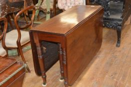 A William IV mahogany dropleaf dining table, the top with reeded edge and rounded corners, on ring-