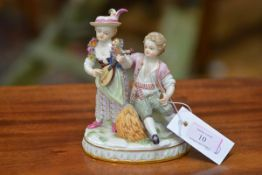 A Meissen figure group, late 19th century, emblematic of Autumn, of a boy and girl, she playing a