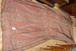 A woollen Paisley shawl, worked in reds and greens. Length 300cm, width 145cm