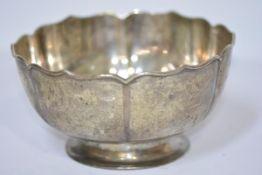 A Chinese silver bowl, c. 1900, Wang Hing & Co., Hong Kong, with petal lobed rim, plain body and