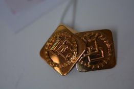 A pair of Indian yellow metal cufflinks, the square monogrammed plate with chain link to a