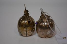 A pair of Chinese white metal pumpkin or water melon condiments, early 20th century, unmarked. 6cm