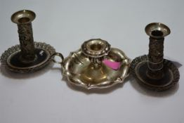 A pair of 19th century Continental white metal candlesticks, each with detachable candle cup on a