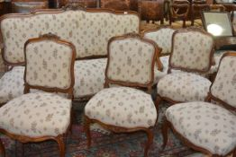 A suite of Louis XV style walnut-framed salon furniture comprising a canape and four chairs, the