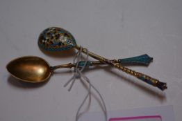 Two Russian cloisonne enamelled silver-gilt teaspoons, one with 84 standard mark, the other