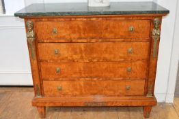 A gilt-metal mounted marbled topped chest of drawers in the Empire taste, the rectangular top over