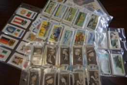 A collection of cigarette and tea cards including a set of Players sepia racing caricatures,