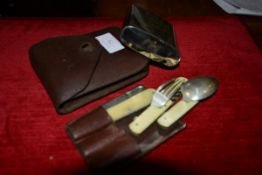 An officer's leather cased travelling spoon, knife and fork field set, the folding implements
