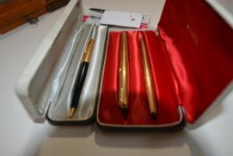 A vintage Parker 1/10 12ct rolled gold two pen set, cased; together with a Parker 1/10 12ct rolled