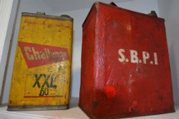 Two vintage oil cans, Challenge Oil and another marked SBPI (2)