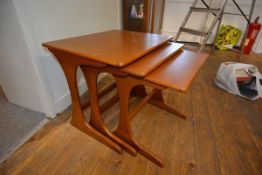 A nest of three 1970's/80's teak occasional tables