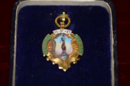 A 9ct gold and enamel Rugby Union medal, decorated with an image of the Border Reiver statue, the