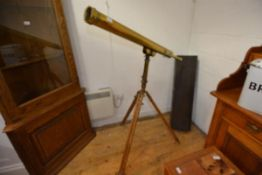 "A floorstanding brass telescope in 19th century style, on a tripod base, marked ""Aronsbery & Co."