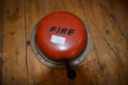 A 1960's wall-mountee wind fire alarm; together with a white metal ice bucket (2)