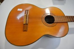 A vintage Terada (Japan) acoustic six-string guitar, with paper label, no. 1200, with carrying