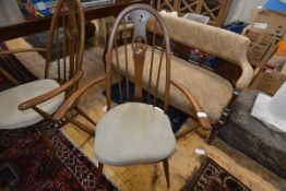 A pair of vintage Ercol swan-back carver chairs