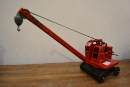 A vintage tinplate Tri-ang model of a Jones KL 44 crane with George Cohen & Sons inscription to