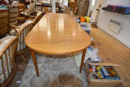 A vintage Troeds (Sweden) teak extending dining table, with d-ends and two leaves, raised on