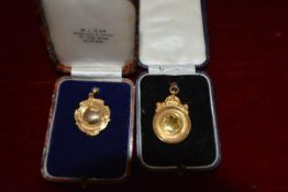 Two 9ct gold sporting medals, unengraved, each in a fitted case, one for W.J. Blair, High St.
