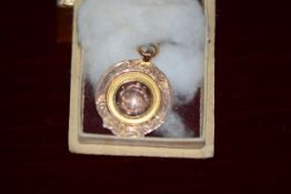 """A 9ct rose and yellow gold Rugby Union medal, engraved with a monogram, the reverse inscribed """""""