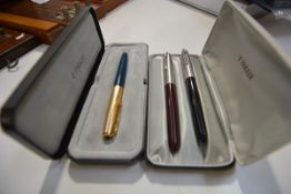 A vintage cased Parker fountain pen, with 1/10 12ct rolled gold cap and green body; together with