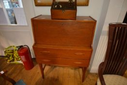 A vintage teak bureau with fall front over two long drawers