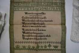 An early 19th century sampler, worked in green and black threads by Isabella Gowan, Whitehaven,