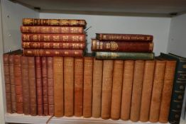 A collection of leather volumes including works by William Makepeace Thackeray and Charles Dickens