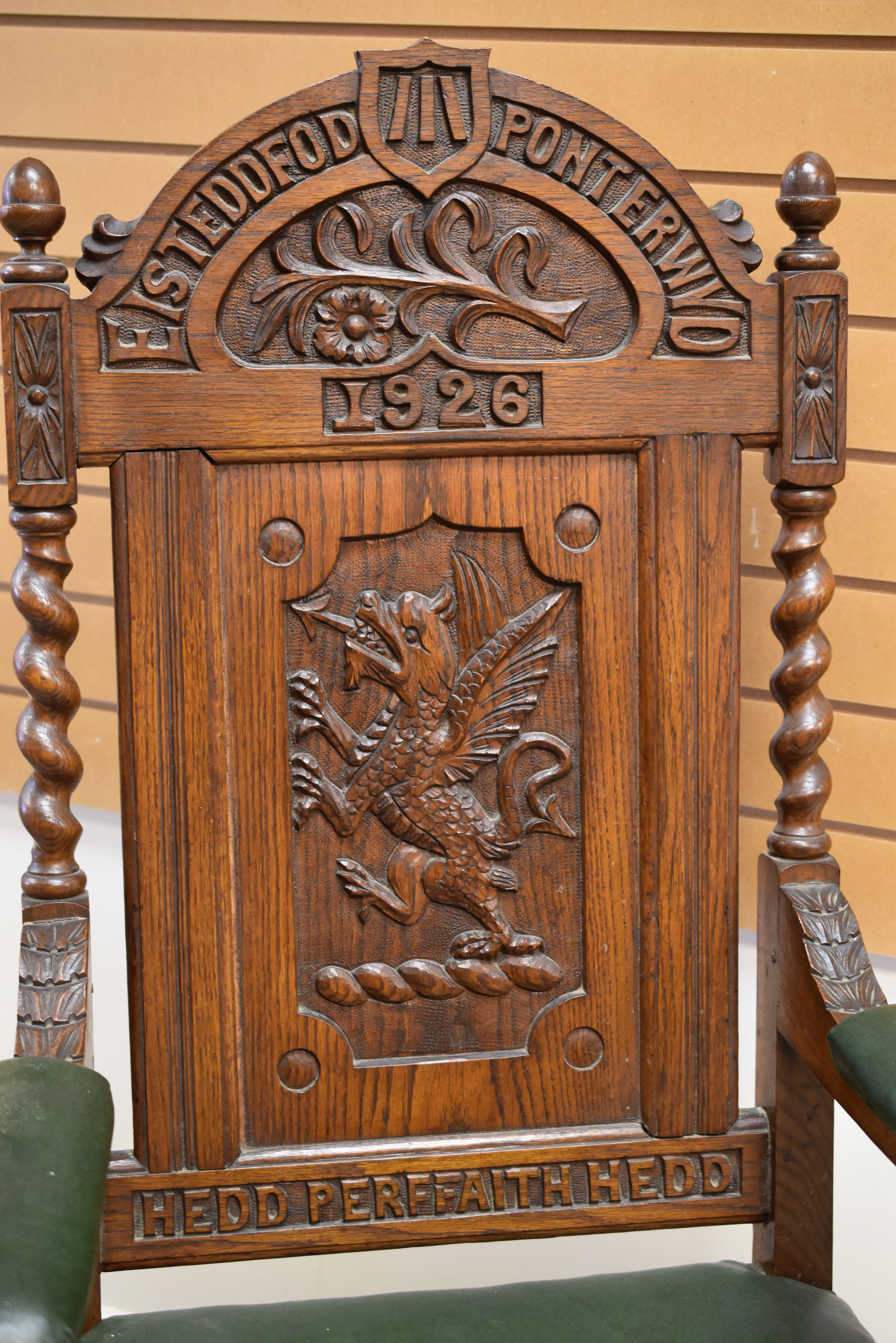 A WELSH EISTEDDFOD CHAIR carved with a dragon to the back and with leek and daffodil above, - Image 2 of 2