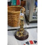 A glass cased Franz Hermle clock