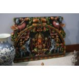 A heavily carved Indian panel