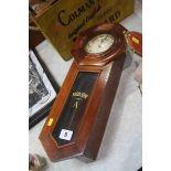 A mahogany cased wall clock