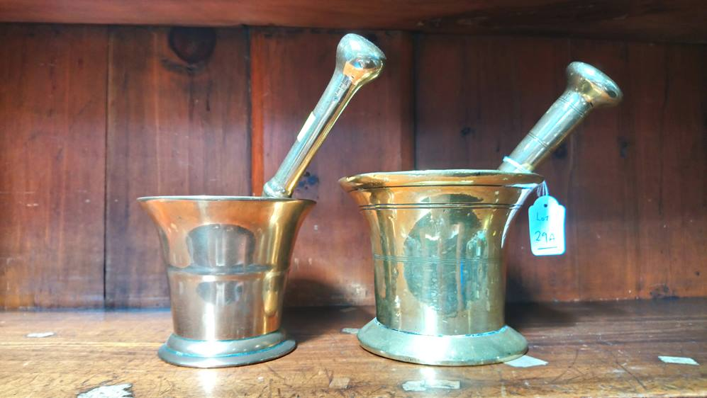 Two brass pestle and mortars