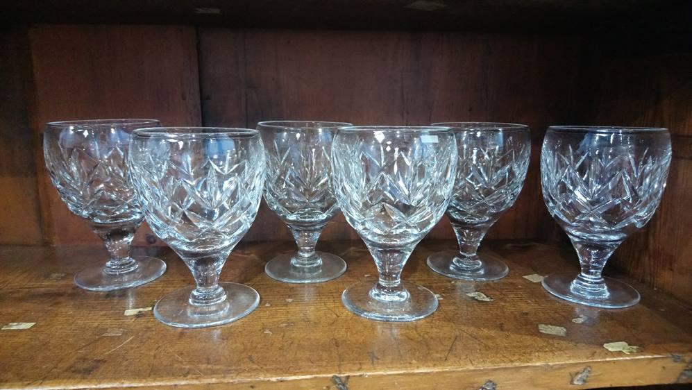 Six heavy cut glass wine glasses