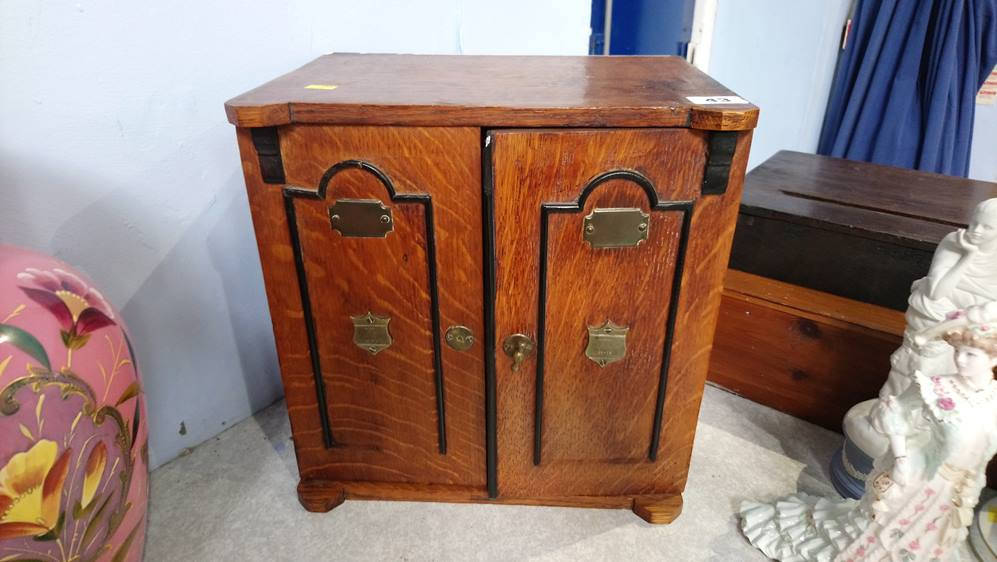 Oak smokers cabinet in the form of a Safe