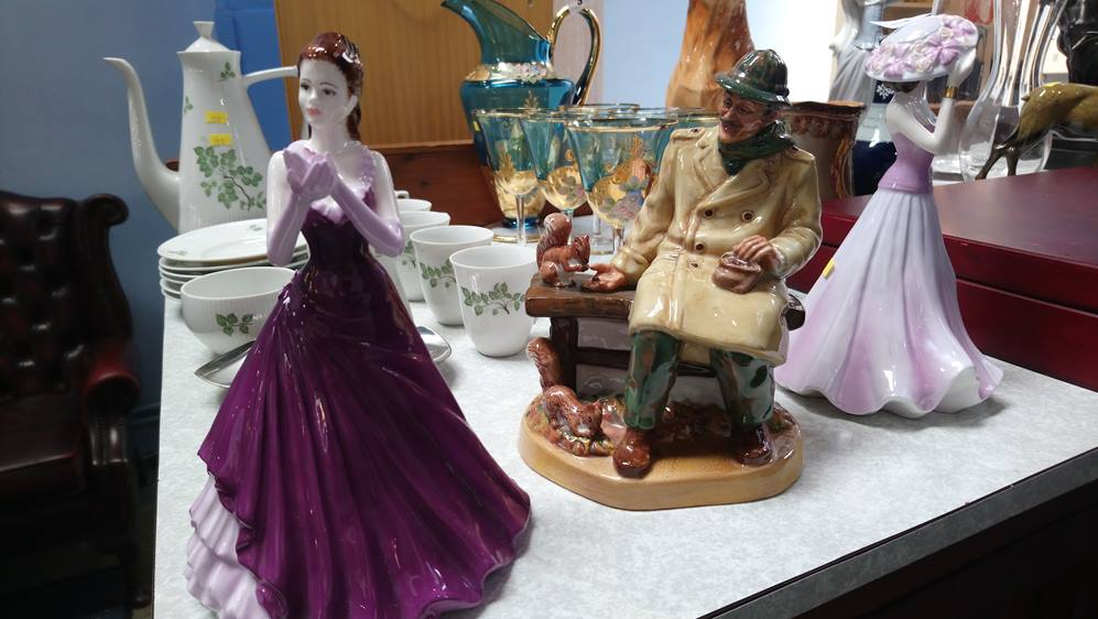 A Royal Doulton figure and two Coalport ladies