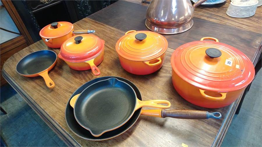 Lot 25 - A collection of Le Creuset pans and frying pans. (7)