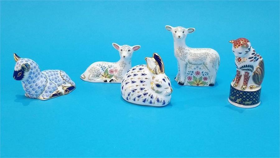 Lot 31 - Five Royal Crown Derby paperweights of lambs, rabbit and a cat (no boxes or certificates).